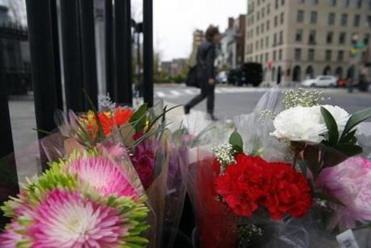 A box of flowers sat at the scene of Saturday's fatal crash involving a duck boat and a woman riding a scooter in Boston.